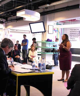 Tara Reed, CEO of Kollecto, pitches during Demo Day at ZINC