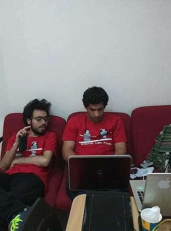 Coders hard at work during Angelhack Amman. Image via QRCE