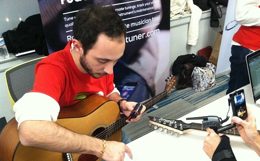 Bassam Jalgha tuning his guitar using Roadie Tuner